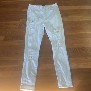 Brand new Bebe destructed white jeans. Size 28.